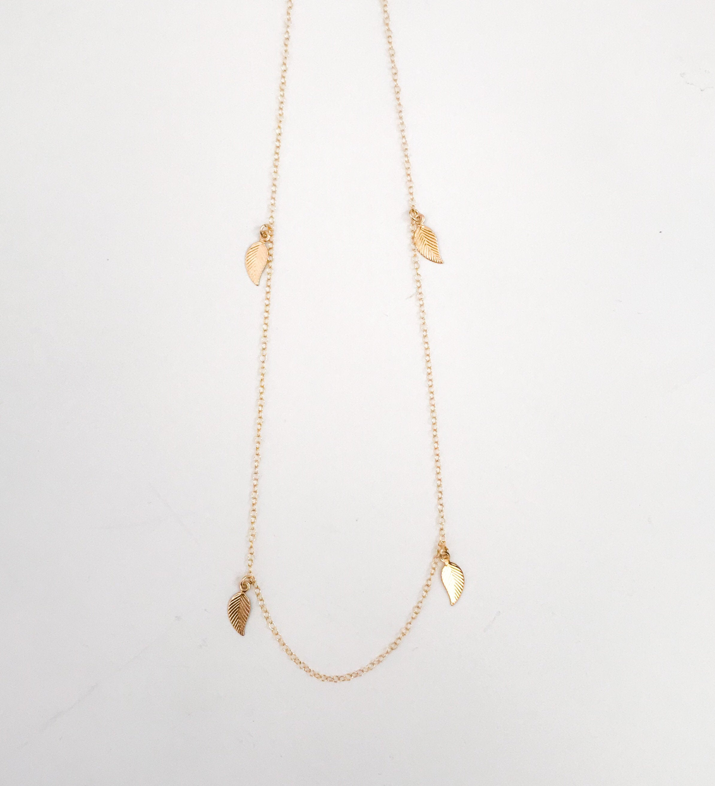 Gold leaf charm necklace/ Tiny leaf charm short necklace