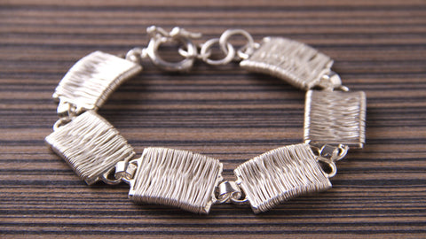 slow fashion silver threads bracelet