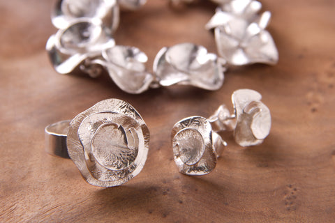 Handcrafted silver jewelry roses design