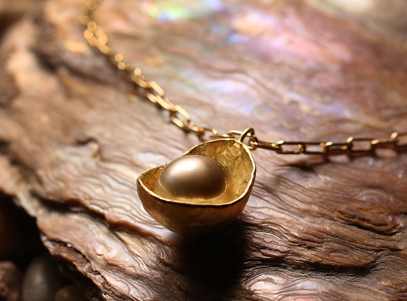 20k yellow gold, tahitian pearl  .  About The Artist Maya was born in 1977 in Boston. She studied sculpture and literature and has a 2007 Masters in Metalsmithing from Cranbrook Academy of Art. Maya's work is made near the water in her San Francisco studio.