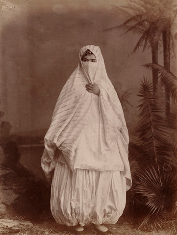 19th century Algerian woman wearing the traditional pants which inspired 'harem pants'.