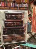 Architextures™ Treasures - Stacked Leather Suitcases