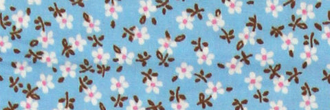 Photo of the Flowers in White and Pink on Sky Blue Contrast Fabric