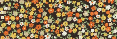 Photo of the Flowers in Orange and Yellow on Black Contrast Fabric