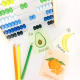 Flashcards with images of fruits and corresponding letters.