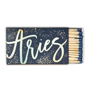 "A naby box of matches with a calligraphy: ""ARIES"" and splashes of stars."