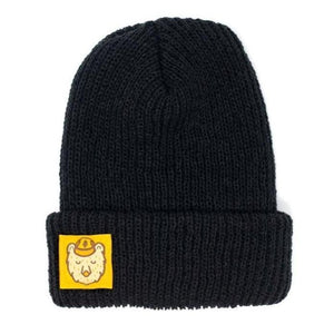 A black Beanie with a yellow square ranger bear patch.