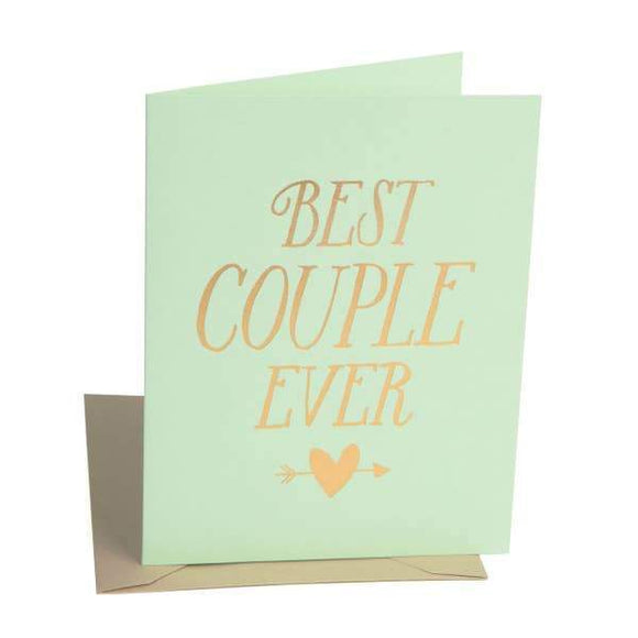 A pistachio colored card with a golden text: