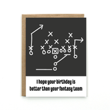 "A black and white card with text: ""I HOPE YOUR BIRTHDAY IS BETTER THAN YOUR FANTASY TEAM."" and an illustration of a game plan design."