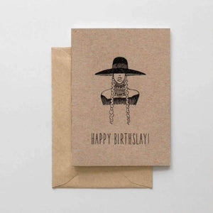 "A brown card with a black text: ""HAPPY BIRTHSLAY!"" and an illustration of a lady with a big hat. Comes with a brown envelope."