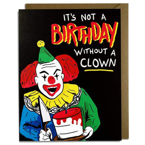 "A black card with text ""IT'S NOT A BIRTHDAY WITHOUT A CLOWN!"" and an illustration of a creepy clown with a knife and a cake. Comes with a brown envelope."