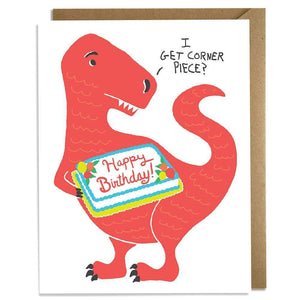 "A white card with an illustration of a red dinosaur holding a birthday cake asking ""I GET CORNER PIECE?"" Comes with a brown envelope"