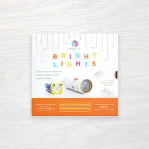 "White box kit with text ""BRIGHT LIGHTS"""