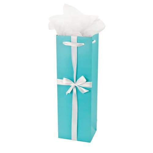 A blue wine gift bag with silver ribbons.