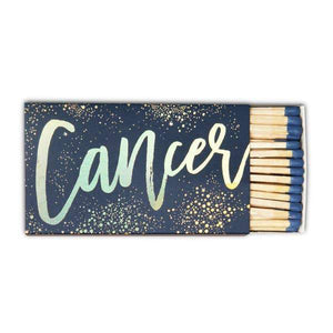 "A naby box of matches with a calligraphy: ""CANCER "" and splashes of stars."