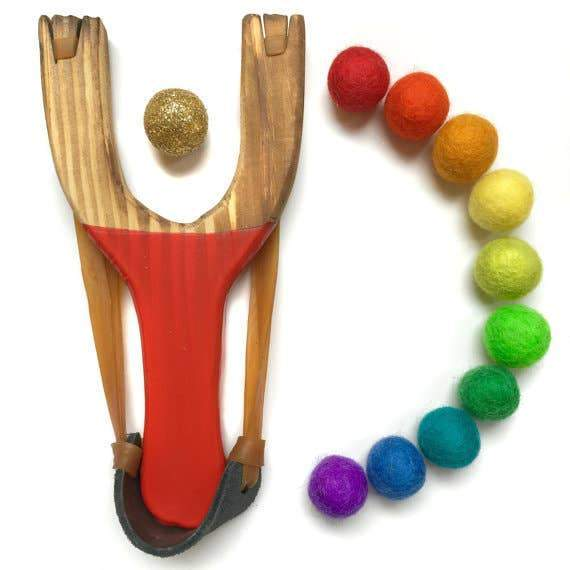 A wooden slingshot with rainbow balls.