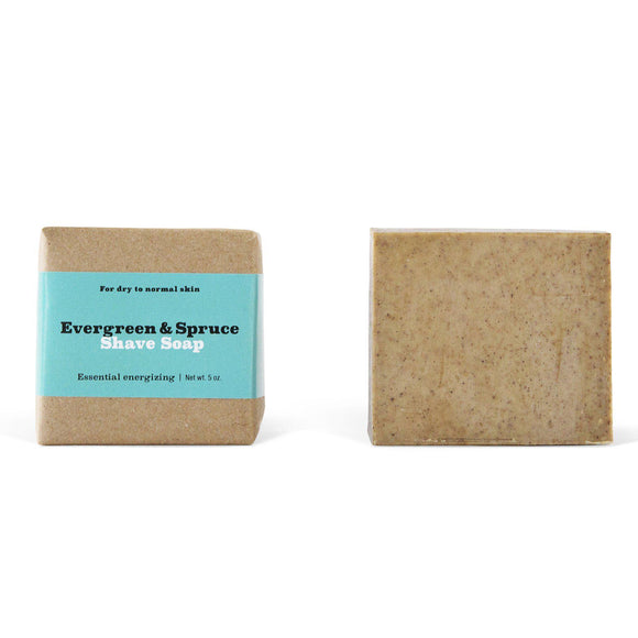 Two beige colored square evergreen and spruce shave soap bars.