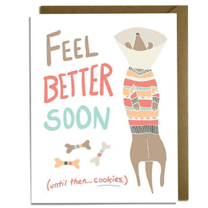 "A white card with colorful text: ""FEEL BETTER SOON. UNTIL THEN, COOKIES..."" and an illustration of a dog wearing a colorful sweater."