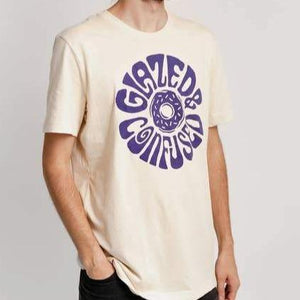 "A cream colored t shirt with blue text: ""GLAZED AND CONFUSED"" and an illustration of a doughnut in the center."