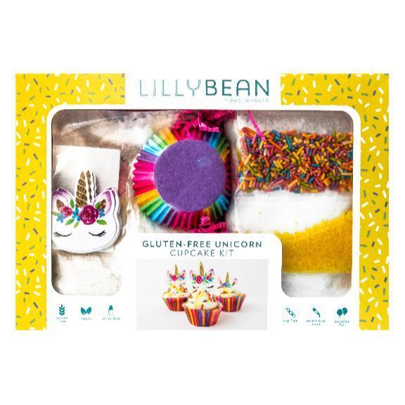 Cupcake baking kit with colorful baking cups and unicorn decorations.