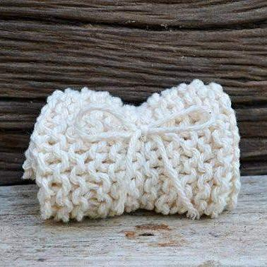 A white knitted washcloth.