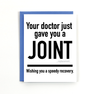 "A white card with a black text: ""YOUR DOCTOR JUST GAVE YOU A JOINT. WISHING YOU A SPEEDY RECOVERY."" Comes with a blue envelope."