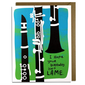 "A blue/green card with text: ""I HOPE YOUR BIRTHDAY ISN'T LAME"" and an illustration of three clarinets. Comes with a brown envelope."