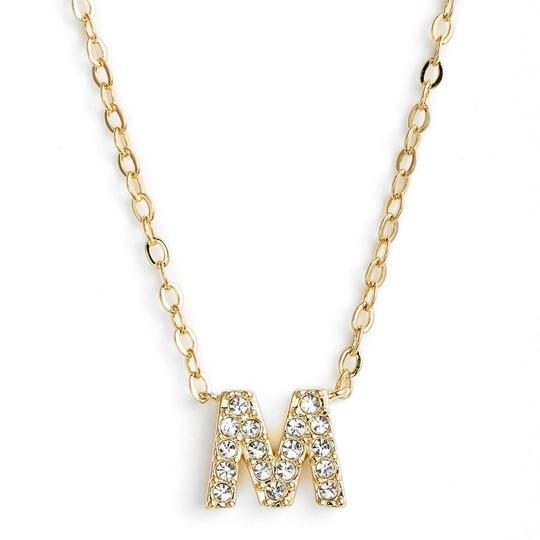 Gold finish chain necklace with M shaped pendent made with CZ stones.