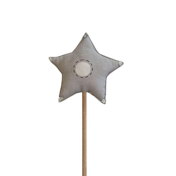 A wooden wand with a cotton top in shape of a star.