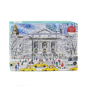 A box of puzzles with an illustration of the New York Public Library in the winter.