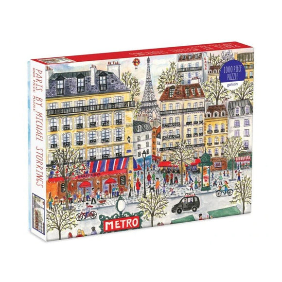 A box of puzzles with an illustration of a street in Paris.