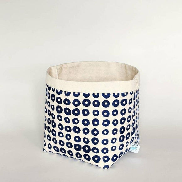 Canvas bin with navy circle patterns.