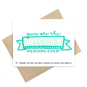 "A white card with a blue text: ""YOU ARE THE NICEST PERSON EVER."" Comes with a brown envelope."