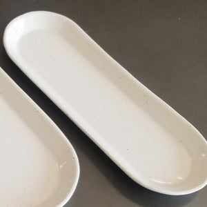 A long white stoneware nesting tray in small size.