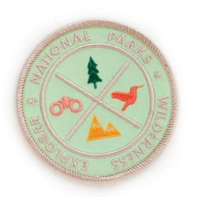 A sage colored round patch with text: