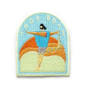 "An arc shaped sticky patch with text: ""YOGA BOYS"" with an illustration of a man doing the dancer pose."