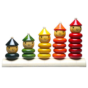 Five sets of stacking toys in different colors.