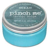 "A blue jar of ""OCEAN"" therapy dough."