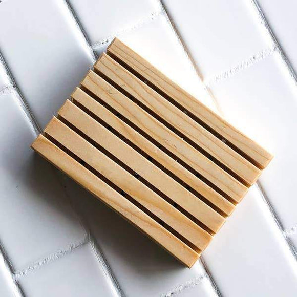 A rectangle wooden soap holder.