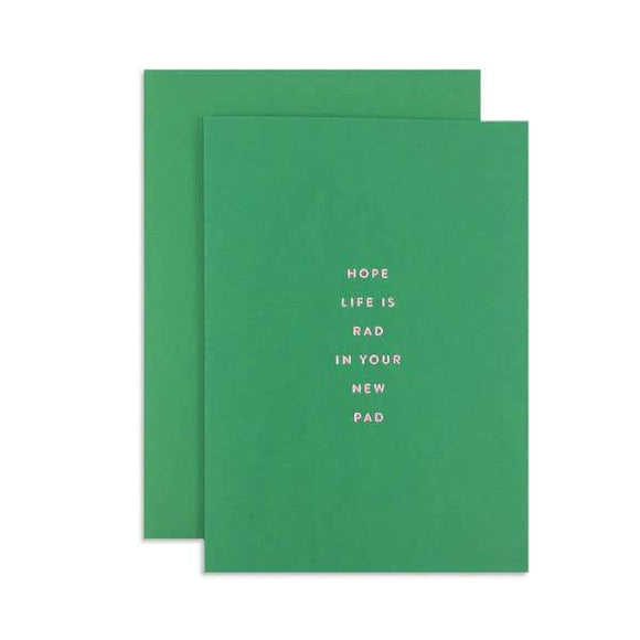 A green card with a golden text:
