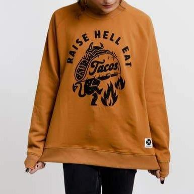 A light brown sweatshirt with a black text: