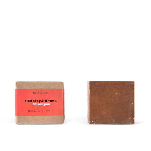 Two brown square red clay and henna shampoo bars.