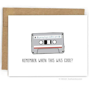 "A white card with a black text: ""REMEMBER WHEN THIS WAS COOL?"" and an illsutration of a cassette tape."