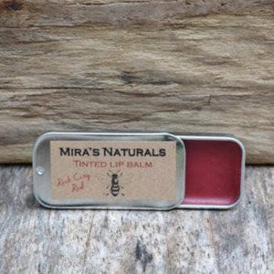 A tin of natural tinted lip balm.
