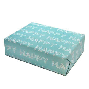 "A present wrapped in light blue wrapping paper with white texts: ""HAPPY."""