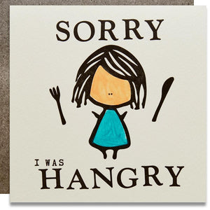 "A white square card with text: ""SORRY I WAS HANGRY"" and an illustrations of a girl with a knife and a fork. Comes with a brown envelope."