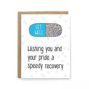"A white card with a black text: ""WISHING YOU AND YOUR PRIDE A SPEEDY RECOVERY"" and an illustration of a colorful pill."