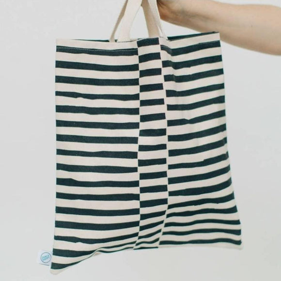 A cotton canvas tote bag with black and white staggered stripes design.
