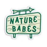 "A sticker of a blue sign that reads: ""NATURE BABES."""