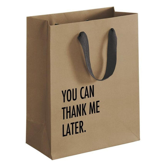A brown gift bag with a black text: